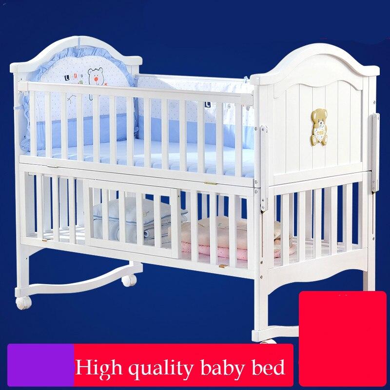 Haute qualité solide lit bébé en bois multi-fonctionnelle nouveau-né lit enfant shaker lit jeu parc néonatale épissage lit variable bureau