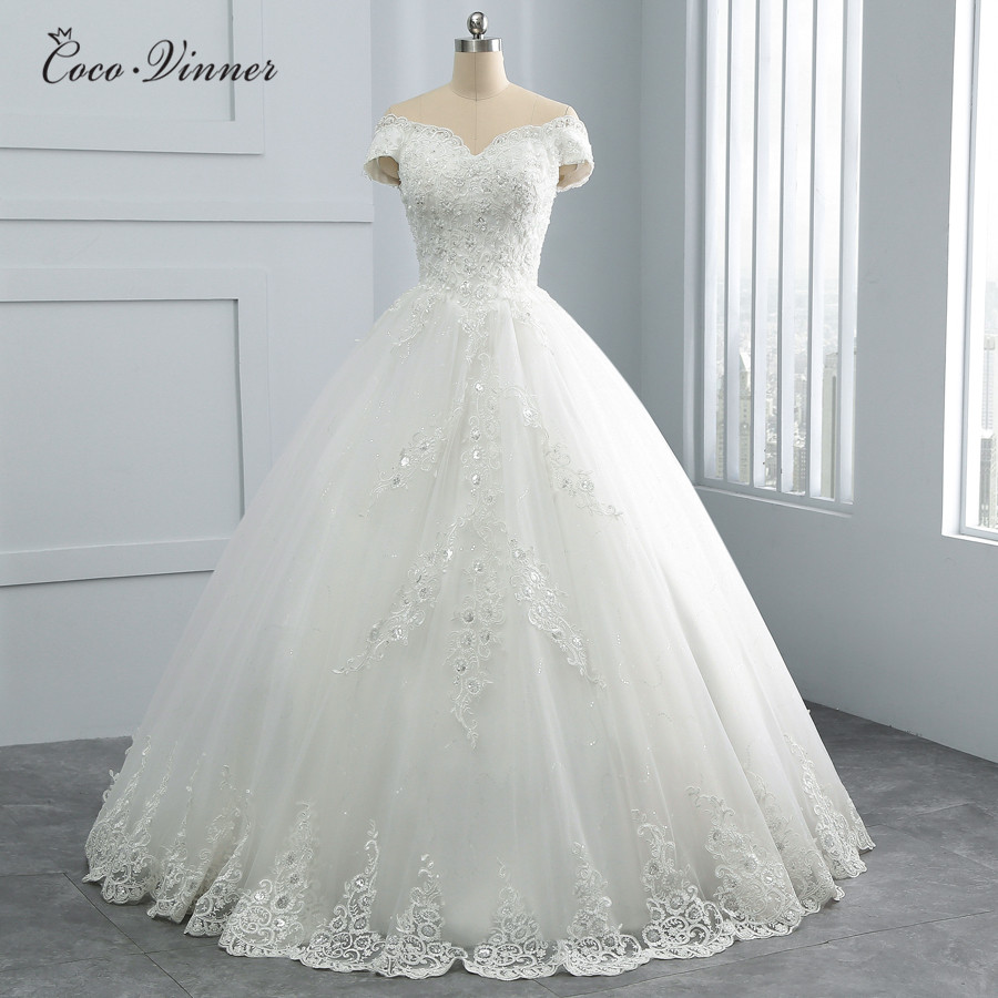 Pearls Beaded Ball Gown Wedding Dresses 2019 New Design Sequin Lace Cap Sleeve Plus Size Arabic Princess Wedding Dress WX0108