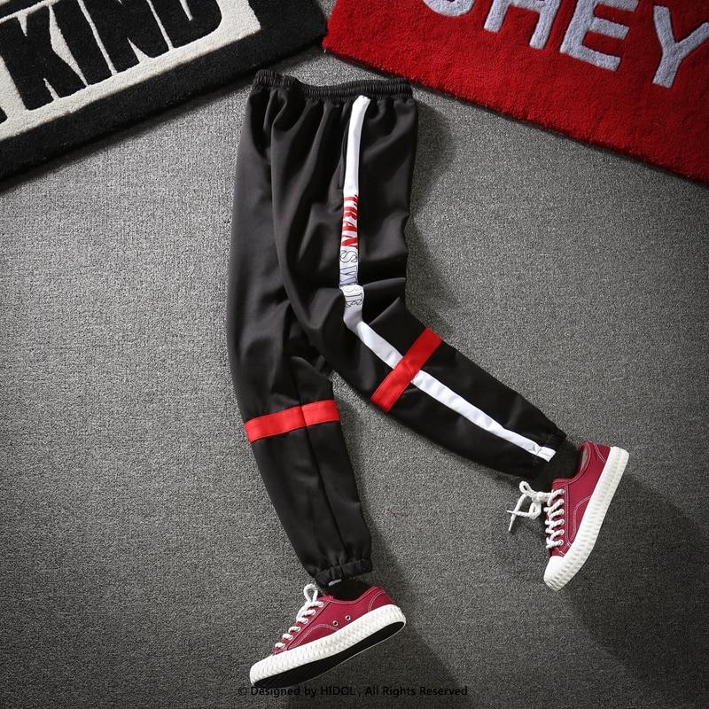 4ffa1c5daec59 Cruz Patchwork pista pantalones rayados laterales Retro Sportwear  Sweatpants hombres Hip Hop Streetwear urbana escuela pantalones Vintage  Pantalones en ...