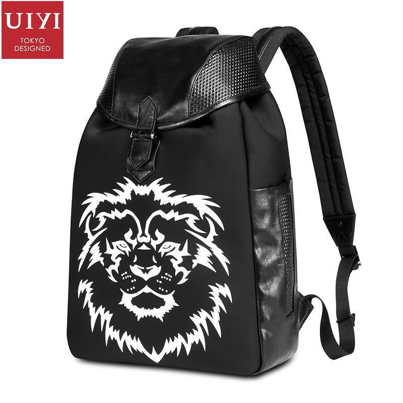 ФОТО UIYI Fashion Brand Women Men Charm Black PVC Leather Zipper Student Laptop Multilayer Lion Pattern Knapsack School Bags 160181
