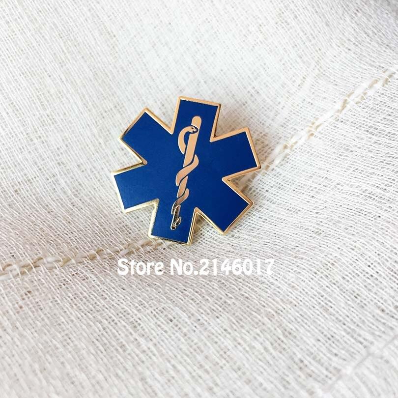 55e96296e Esmalte azul serpiente símbolo Metal insignia regalo calidad estrella de la  vida enfermería ambulancia solapa Pin paramídico-hierro Doctor pines broche