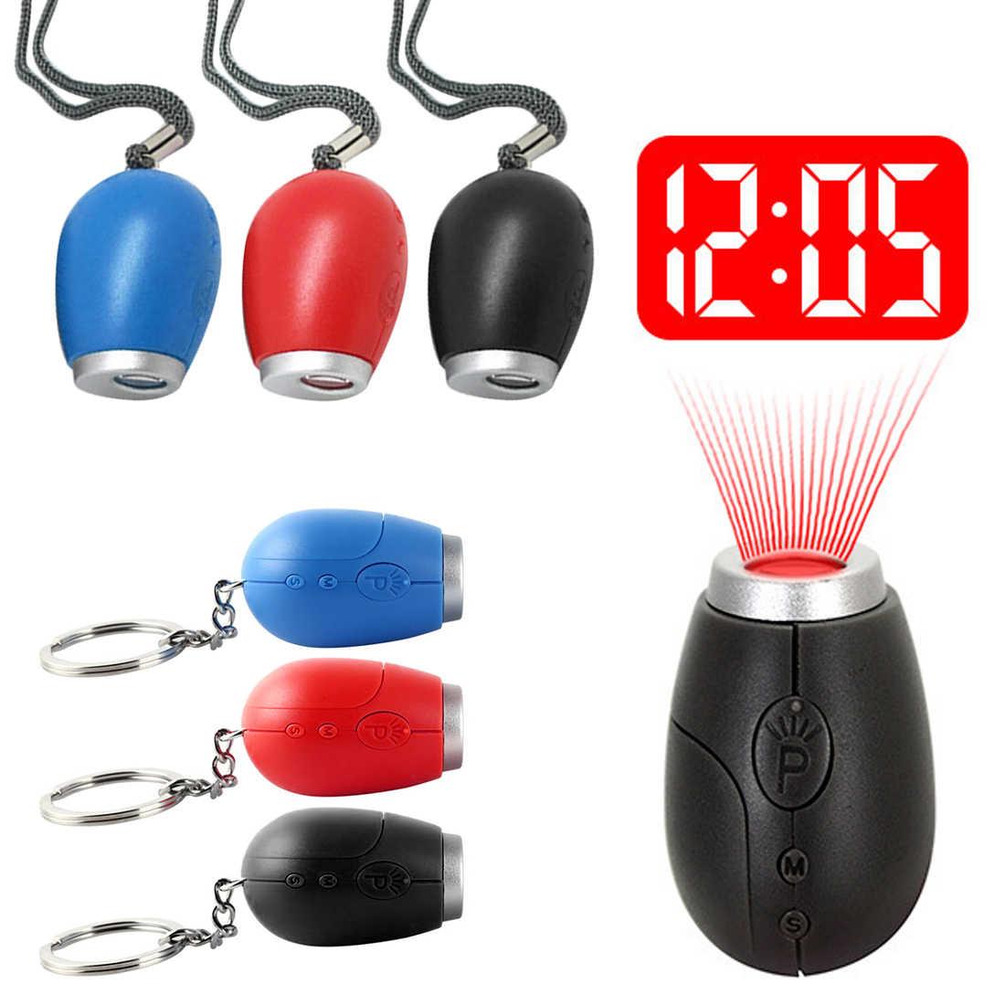 ساعة الإسقاط الرقمية ساعة تنبيه صغيرة دلاية مفاتيح LED ساعة ذات تصميم رائع ليلة ضوء السحر العارض على مدار الساعة مع زر البطارية
