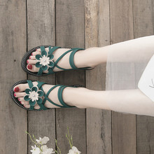 Fashion Gladiator Sandals Flat Rome Style Cross Tied Three-dimensional flower Female