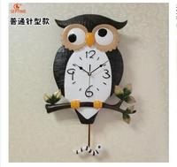 The clocks are ultra quiet personality Home Furnishing innotime owl swing Home Furnishing luminous quartz wall ornaments gift