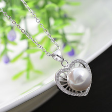 The new lady heart-shaped Necklace  pearl sweater chain Korea jewelry pendant accessories a clavicle