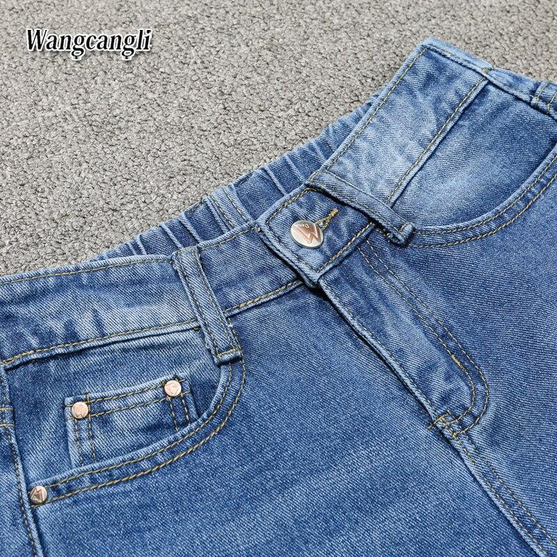 HTB13q77gGSWBuNjSsrbq6y0mVXaJ Fashion Large size women's denim nine pants 2018 spring and summer high waist hole 5XL Blue women's elastic feet pants 015#