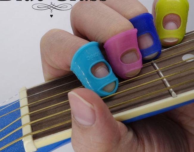 buy hot guitar fingertip protectors silicone finger guards protection ukulele. Black Bedroom Furniture Sets. Home Design Ideas