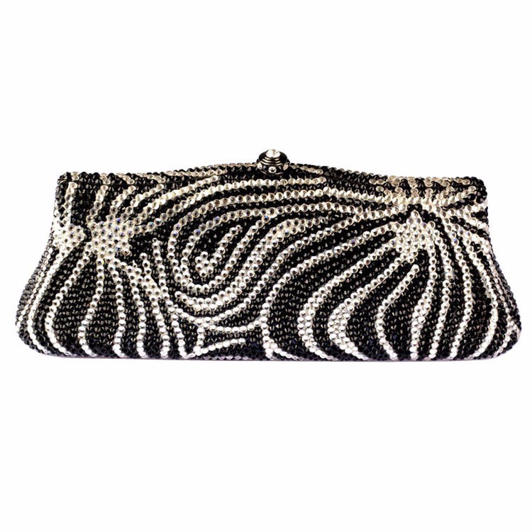 clutches Designer Clutches and Evening Bags. With styles ranging from soft fold-over models to snap-shut oblong hard cases, designer clutches can't be defined by one particular aesthetic.