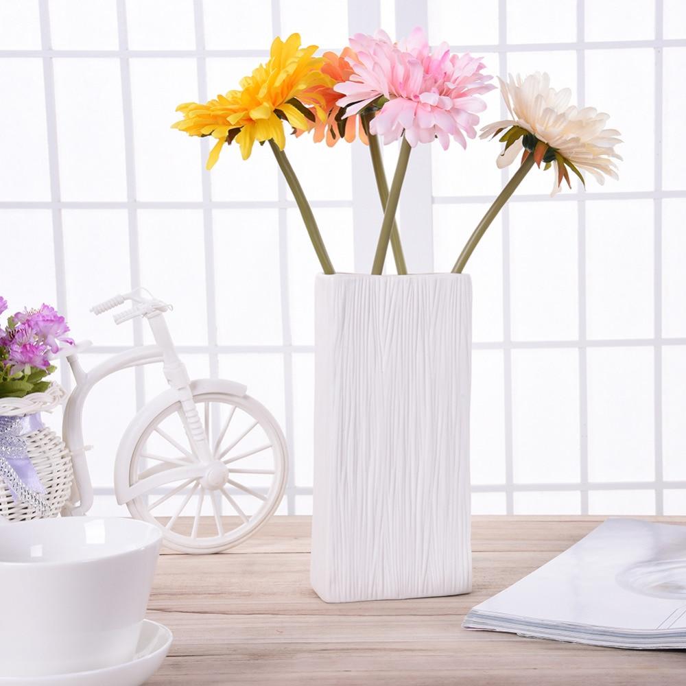 Simple white ceramic flower vase for home decorative vases for Modern home decor vases