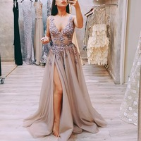 1e9f5577291d Fashionable Tulle Prom Dresses Beaded Sexy High Slit Evening Gowns Deep V  Neck Sleeveless Vestido Formatura