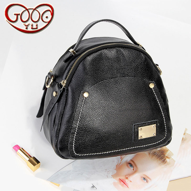 The new Korean version of the first fashion leather handbag magnetic buckle oval shoulder Messenger bag korean version of the first layer of leather vertical section square shoulder messenger bag in the bag fashion casual tassel lea