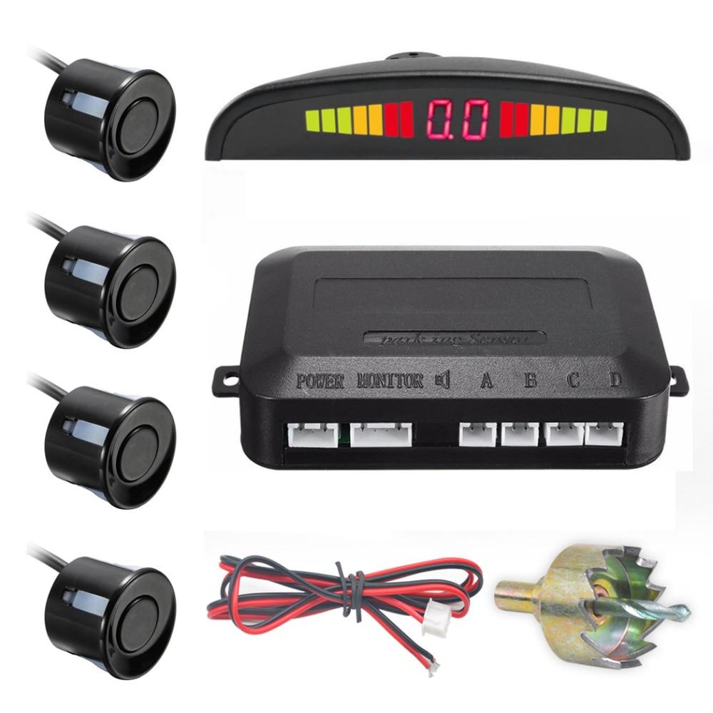 Un conjunto de LED Sensor de aparcamiento auto car detector parktronic display reverse backup radar Monitores sistema 4 Sensores
