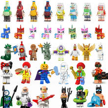 Figurine Limited Cute Cat Milk Drink Batman Robin Joker Halloween Medusa Gingerbread Man Figurines Toys for Children Legoings(China)