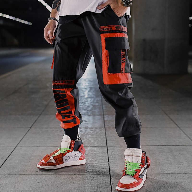 Cargo biegaczy sportowe duża kieszeń spodnie na co dzień mężczyźni Hip Hop męskie Patchwork taniec spodnie Streetwear osłona przed wiatrem Muti kolor spodnie