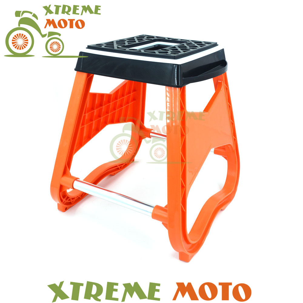 цена Orange Steel Engineering Grade Plastic Motorcycle Dirt Pit Bike Motocross Stand Stool Repairing Lift Repair Support Holder