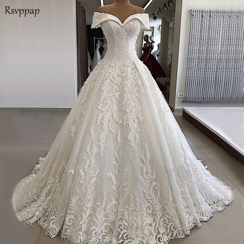 Elegant Luxury Wedding Dress 2019 Cap Sleeve Beaded Applique Saudi Arabia Off White Lace Bridal Wedding Gowns
