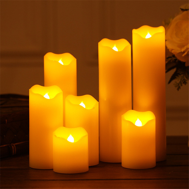 A set of 7 flameless candle battery powered LED true wax flashing electronic led candle