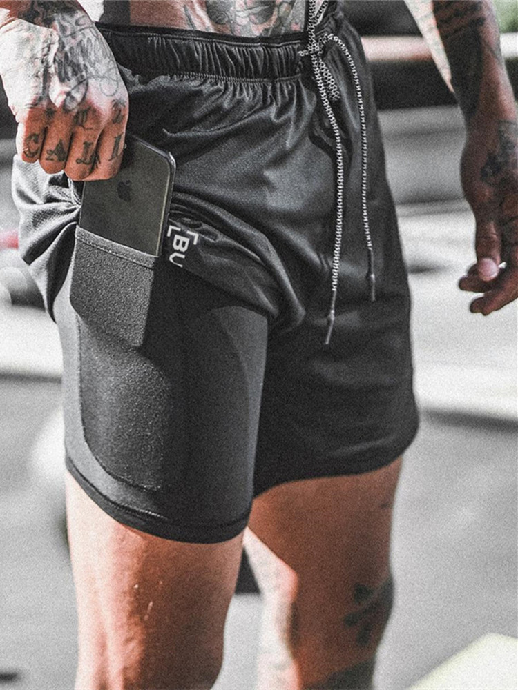 Uomo Jogging Pantaloni Casual Pantaloni sportivi Melange rete fitness sport nuovo print