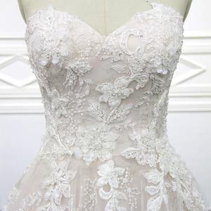 Image 4 - 100% נדל תמונות מתוק לב חתונת שמלות משפט רכבת חתונה Vestido תחרת כלה שמלה עם אגלי XF18074