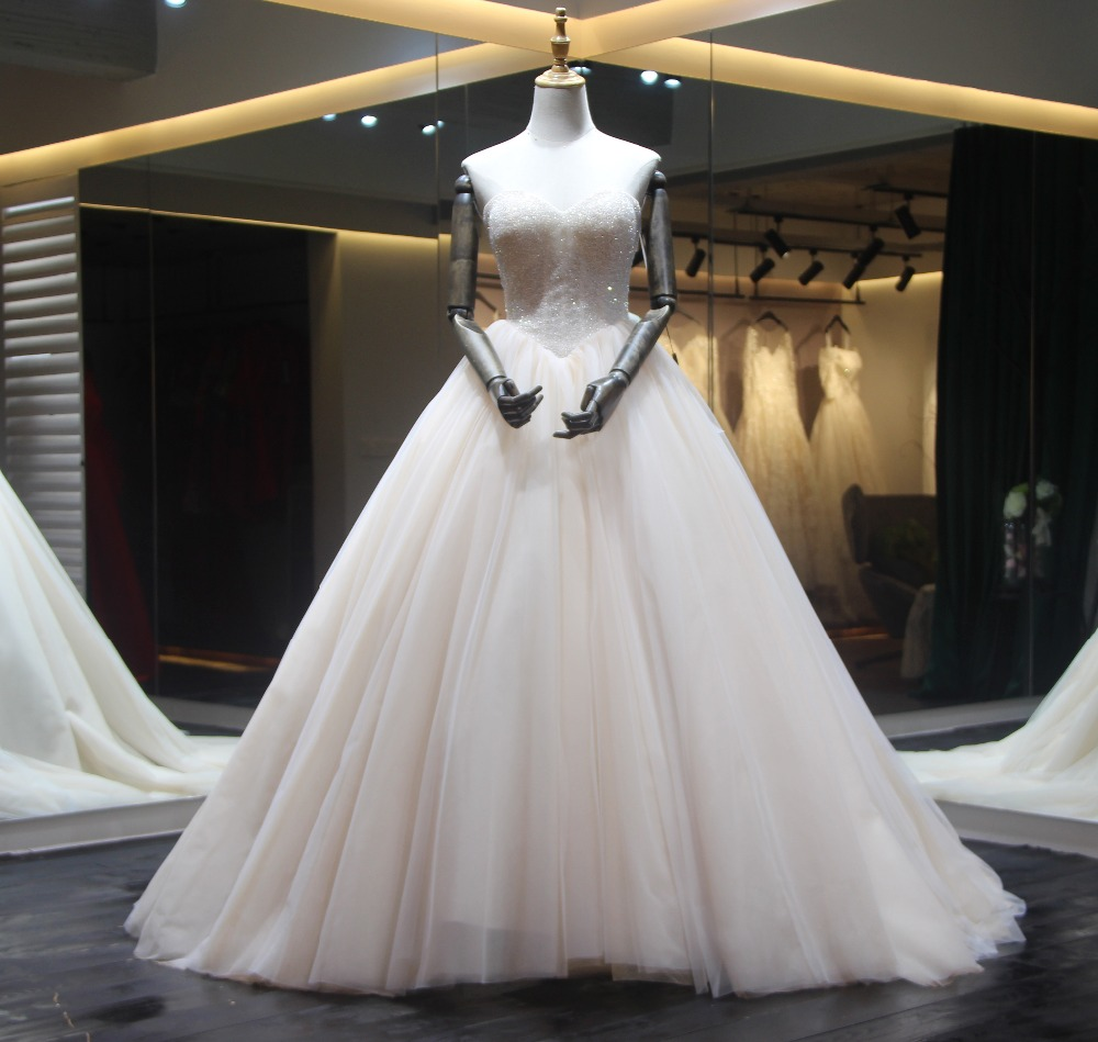 Desain 2018 Gaun Pengantin Vestido de noiva longo Baru Scoop leher Long  Sleeves Chapel Kereta Ball Gown Lace Tulle Bridal GownsUSD 369.00 piece 7a30fd17bc4e