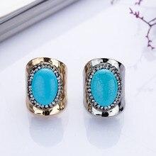 Vente chaude bleu couleur turquoise anneau de pierre gemme pour homme et  femmes MEDBOO nouveau style hyperbole main bijoux régla. 37c3f4b509f9