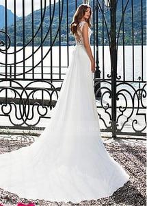 Image 4 - Aantrekkelijke Chiffon Jewel Hals Schede Trouwjurken met Trein Fashion Bruidsjurken Sexy Illusion Terug met Applicaties