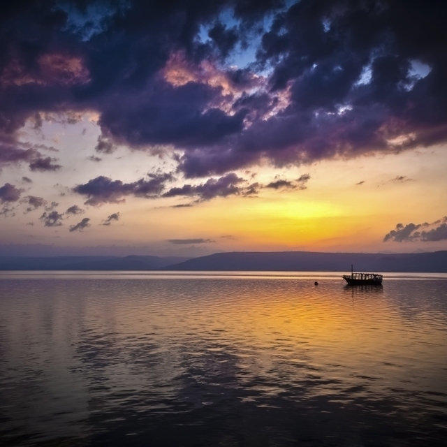 A calm settles on the Sea of Galilee  just after a storm; Galilee  Israel Poster Print (19 x 12)