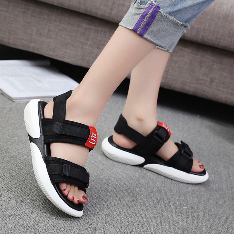 Summer 2018 new flat sandals female students wild magic stickers casual shoes. 55