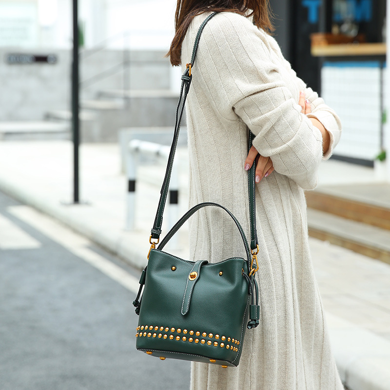 Summer new green bag rivet cowhide bucket bag trend single shoulder diagonal bag joker portable ladies bag wholetide 10 marriage gauze bag bag joker bag silver rose