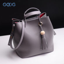 Korean version of the new first layer of buckets bag personalized fashion solid leather handbags tassel(China)