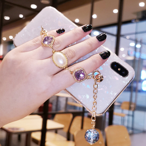 Image 2 - Fancy Pearl Crystal Stone Tassel Diamond Chain Bracelet Shell Phone Case For Huawei P30 P40 Lite Mate 20 30 Pro Y9 Prime 2019