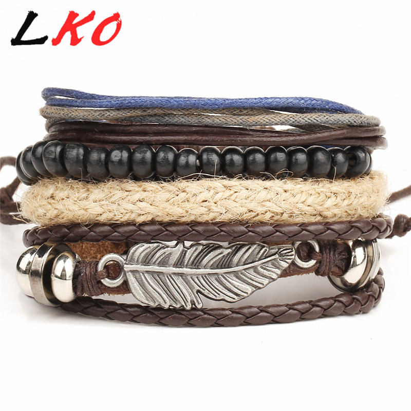 HOT 4pcs 1 Set Punk Genuine Wrap Feather Leather Bracelets Men For Women Cuff Vintage Jewelry Accessories Wholesale