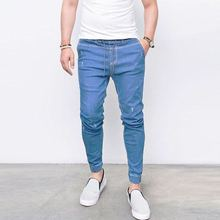 Shinny pantalones para hombres 2018 nueva moda hombres Harem Jeans lavado  pies Hip Hop Sportswear elástico cintura corredores pa. f6b3026cd60