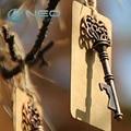 Neo 1 pc antiguo esqueleto de metal de la vendimia clave abridor de botellas Favor de la boda Abridor De Cerveza Rústica Decoración De La Boda con Escolta de la Etiqueta tarjeta