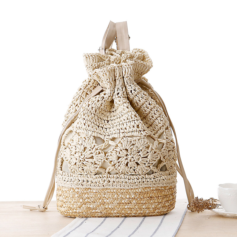 SUDS Summer Drawstring Lace Crochet Straw Beach Bags Designer Högkvalitativ Kvinna Hollow Out Flower Handgjord Strikkad Ryggsäck