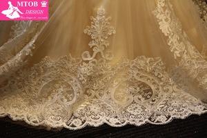 Image 5 - Elegante laço sereia vestido de casamento 2019 champanhe vestido de casamento ver através sem costas vestidos de casamento do vintage mtob1730