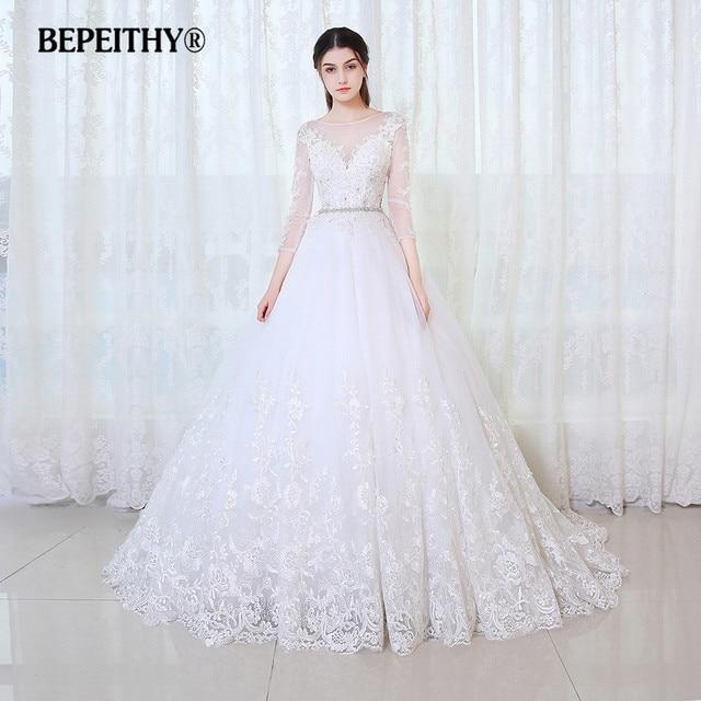 fe5bf4baec9 BEPEITHY robe De bal princesse robe De mariée manches longues avec ceinture  Vestido De Novia 2019