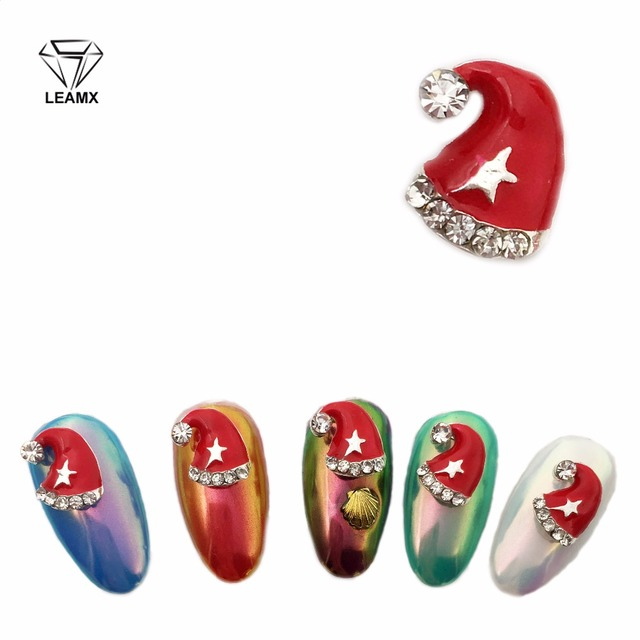 LEAMX 10Pcs New 2018 Glitter Red Christmas Hats Nail Art 3D Rhinestones  Metal Alloy Nail Art Decoration bfa0af7a70d3