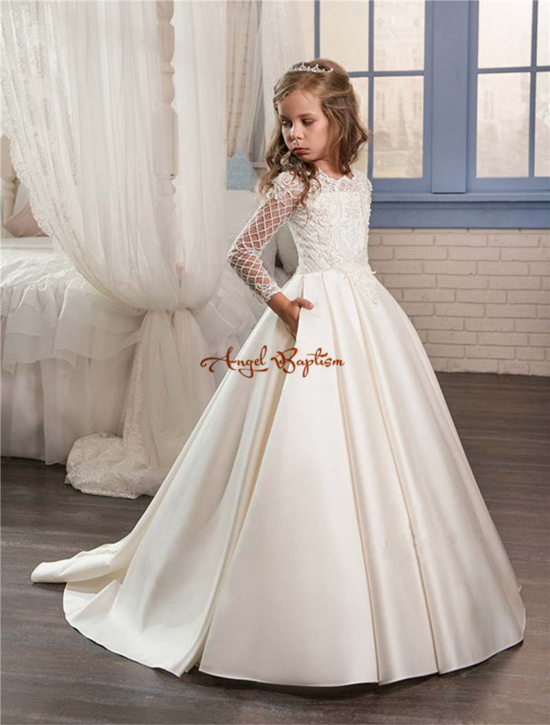 2018 New Princess white ball gown flower girl dresses appliqued satin with tulle long sleeves backless kids first communion gown cute new long sleeves white ball gown flower girl dresses french lace beaded first communion dress with sequin bow and sash