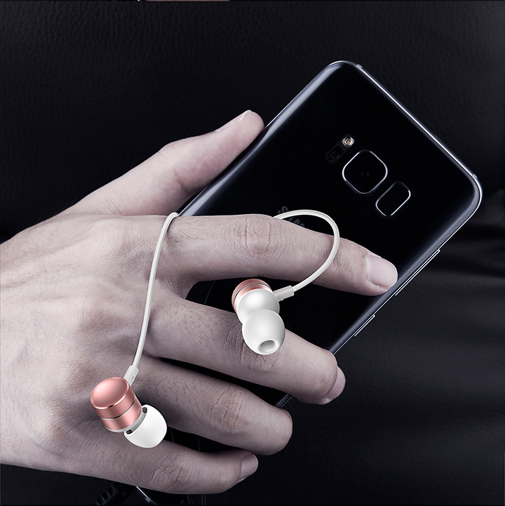 Foto with phone white color In-Ear earphones with microphone. In-Ear earphones with microphone for iphone
