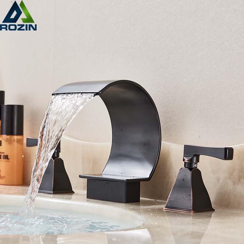 Robinet de salle de bain cascade répandu double poignée en laiton robinet d'eau froide chaude en Bronze noir robinets de lavabo montés sur le pont