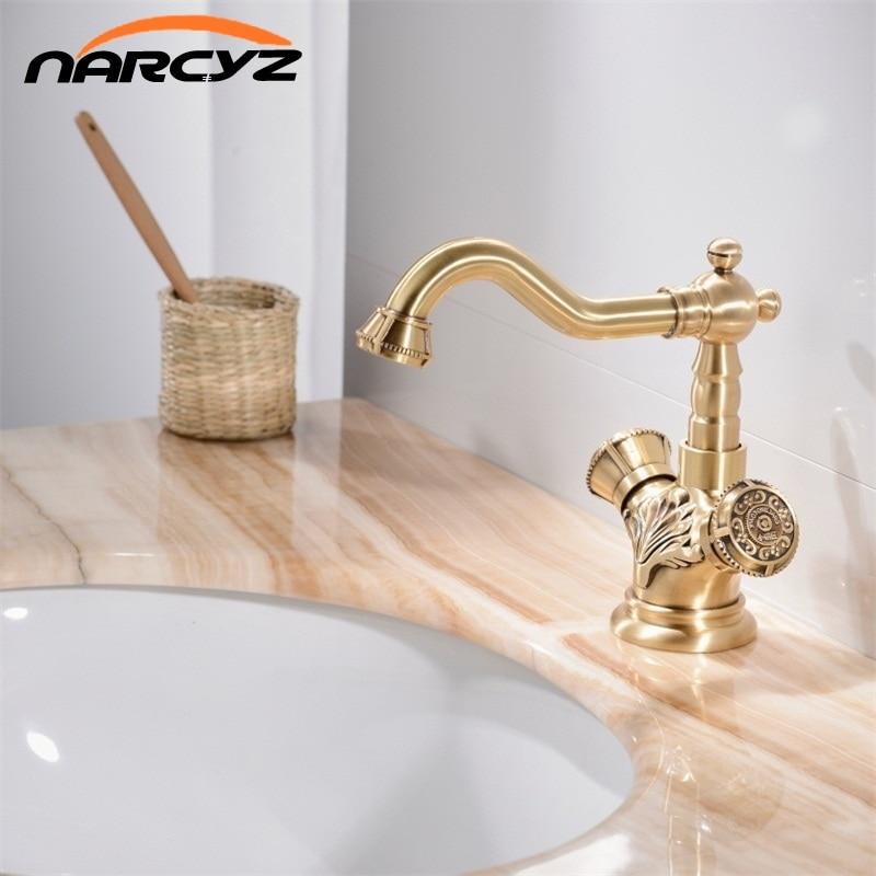 цены на Basin Faucets Antique Brass Bathroom Faucet Basin Carving Tap Rotate Single Handle Hot and Cold Water Mixer Taps Crane XT942 в интернет-магазинах