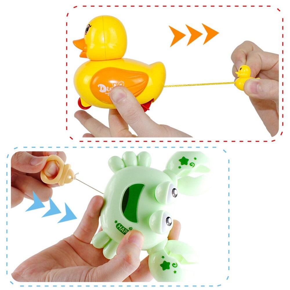 Clockwork Beach  Baby Shower Duck Swimming Penguin Infant Swim  Bath Water Toy