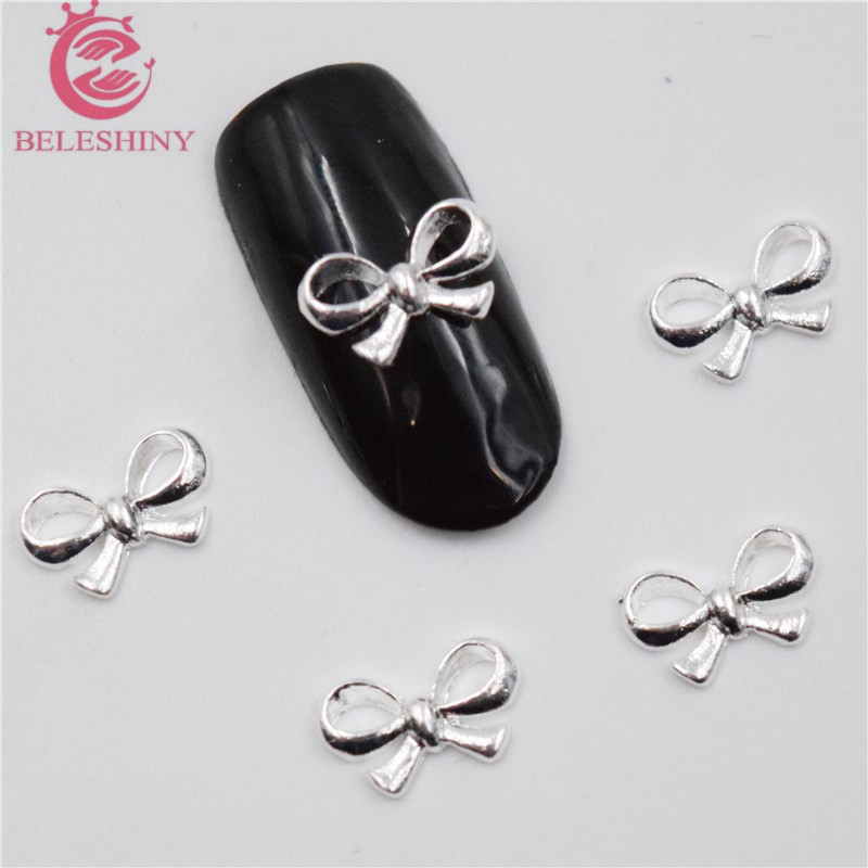 50Pcs new Silver bow nail stickers, 3D Metal Alloy Nail Art Decoration/Charms/Studs,Nails 3d Jewelry nail supplies H085 10pcs gold 3d rudder metal flower pearl music note mixed rhinestones cross nail art decoration jewelry nails supplies y180 187