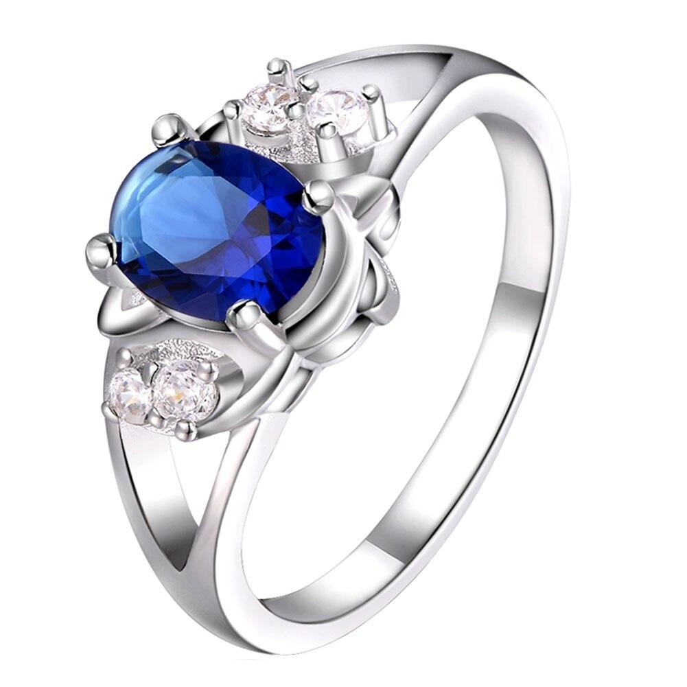 8cc7b2a97d80 Venta caliente de la nueva manera de lujo elegante encanto diseño  Accesorios anillo plateado ZIRCON noble cristal azul