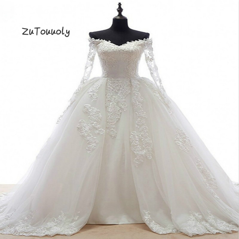 Off The Shoulder Ball Gown Wedding Dresses Illusion Long Sleeves Puffy Tulle Appliques Church Button Back Wedding Gowns 2019