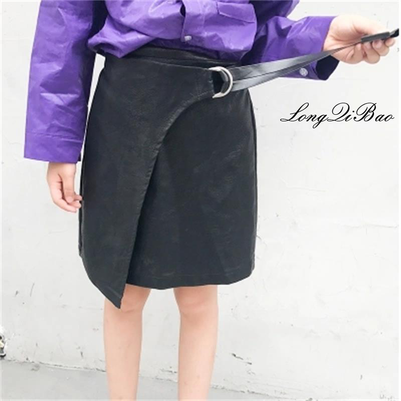 цены на Girls PU skirt 2018 autumn new big children children irregular A word short skirt Korean version of the tide