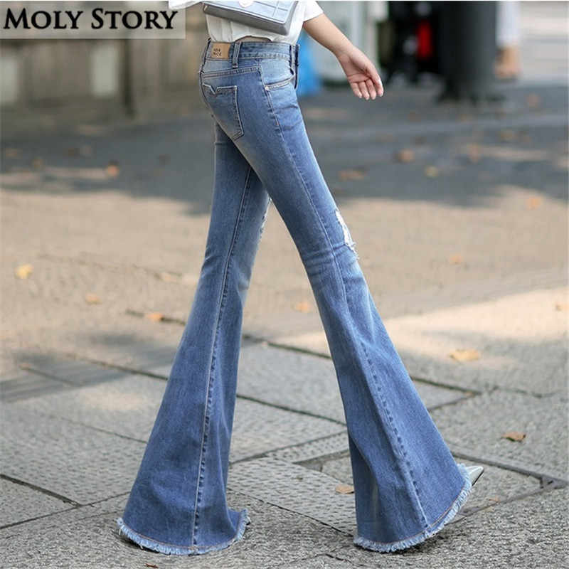 7f7939eb185 Fashion New Vintage Super Flare Jeans Sexy Middle Rise Ripped Jeans Femme  Plus Size Hippie Wide