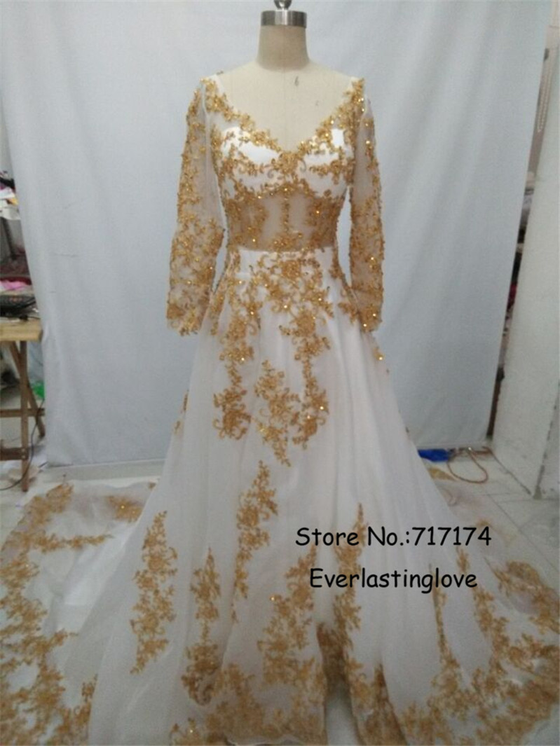 8e0bef67fb This ALine Lace Long Sleeve Muslim Wedding Dress with Gold