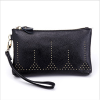 The Latest Leather Hand Bag Fashion Personality Small Rivets Solid Color Zipper Party Bag Brand Designer